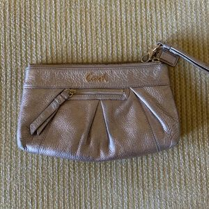 Coach wristlet. Gold/rose gold with gold hardware